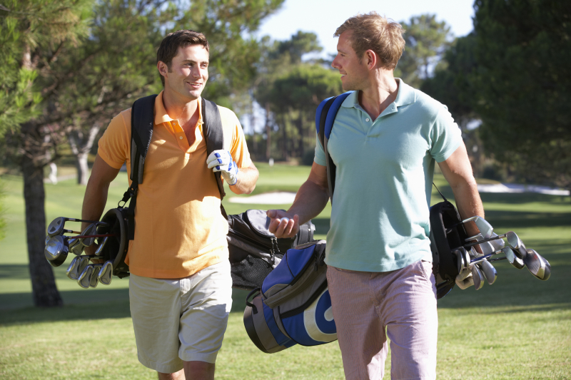 Two golfers walking and talking