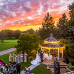 Gazebo wedding with sunset and lights