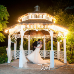 Gazebo lighted up with Bride and Groom