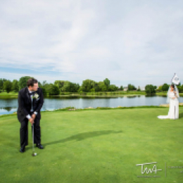 Groom putting at bride on tee box