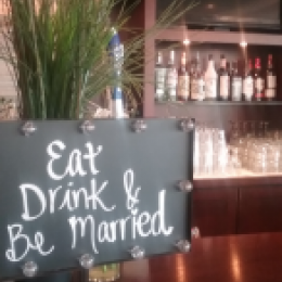 Banquet bar display with wedding sign in front